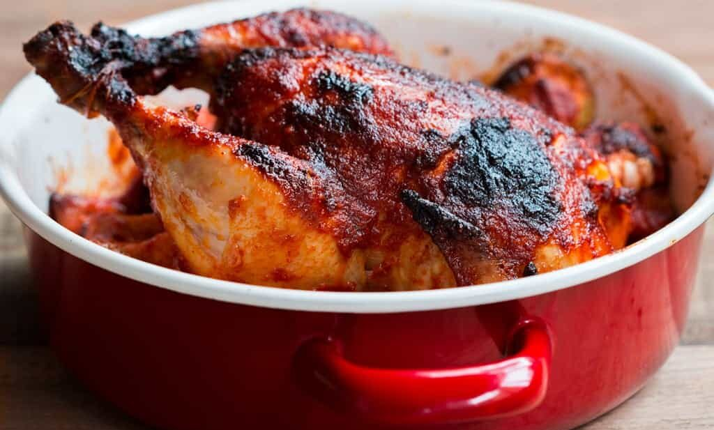 The Indian Style Whole Masala Roast Chicken in a red Fujihoro casserole.