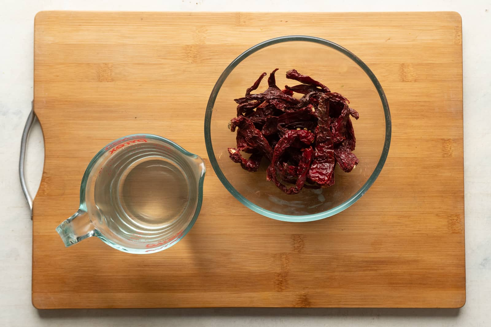 Ingredients for schezwan sauce. Pictures here are chillies and water