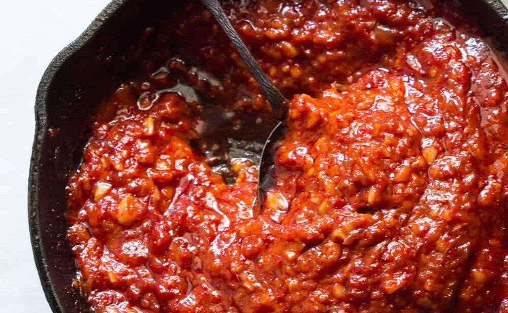 The fiery hot homemade Schezwan sauce.