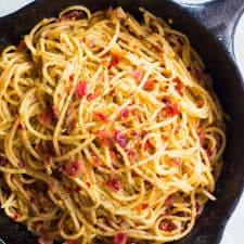 The spaghetti in a cast iron pan.