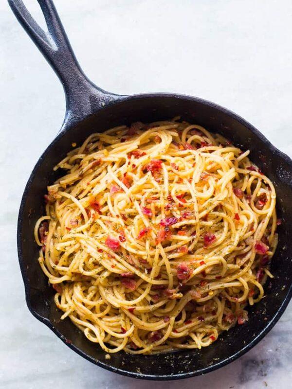 The spaghetti in a cast iron pan.