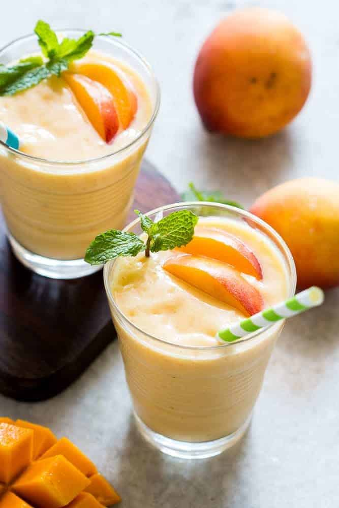 This healthy peach mango smoothie is vegan and the frozen fruit makes it thick and dessert like! Also get my top tips for making the best smoothies!
