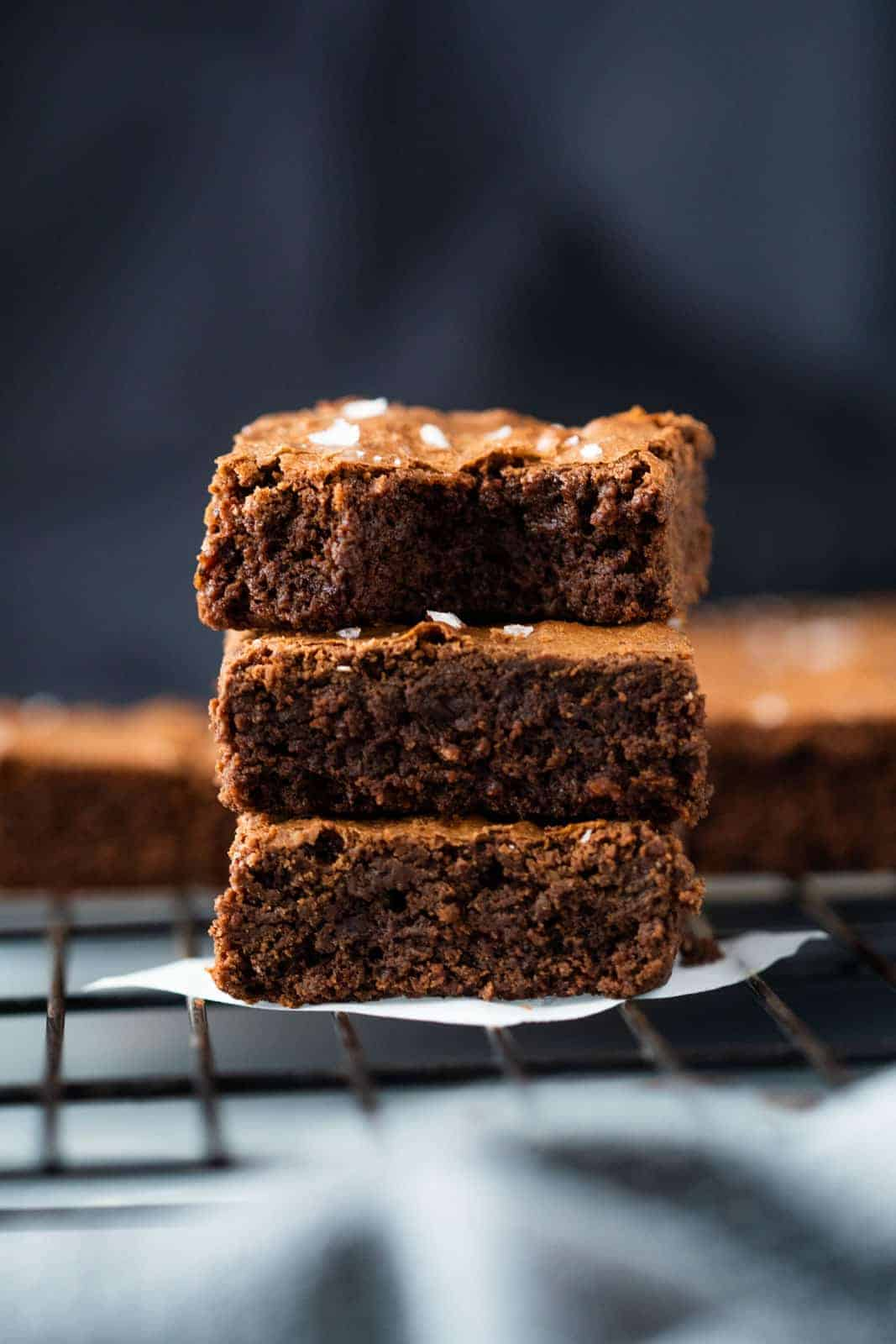 Chickpea Flour Brownies stacked one on top of the other