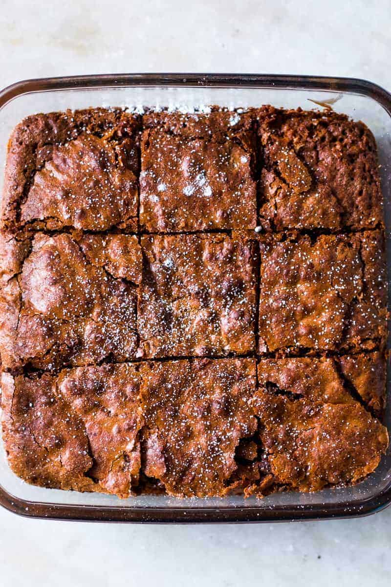 Super easy, gluten free brownies made with chickpea flour (besan) are fudgy, chocolatey and irresistible! You will never guess that there is no all purpose flour in this healthy treat.