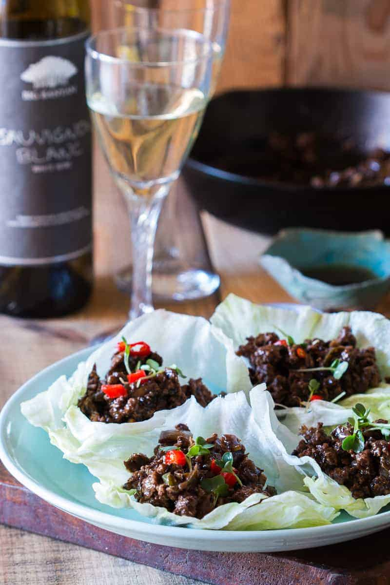 Easy, healthy and insanely delicious stir fried black bean chicken lettuce cups are perfect when you want dinner in 30 mins. Just 5 main ingredients in this gluten free recipe.
