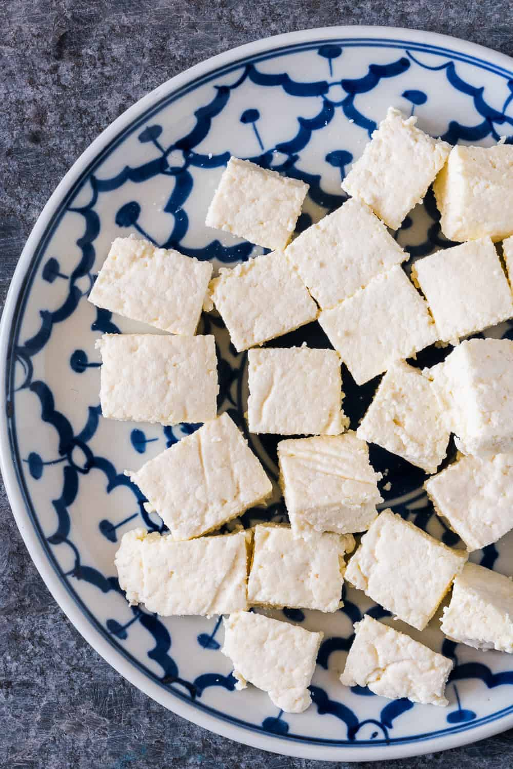 Here's step by step instructions to make homemade Indian paneer (cottage cheese) in just 15 minutes. The next time you want to make saag paneer, palak paneer, makhani, tikka or matar paneer, don't buy store bought and just make this at home with 2 ingredients.