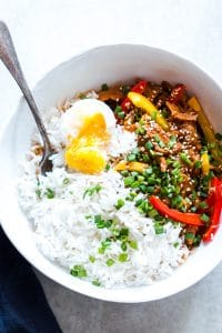 Slow Cooker Korean Pork Bulgogi with Gochujang served with egg and rice in a white bowl.