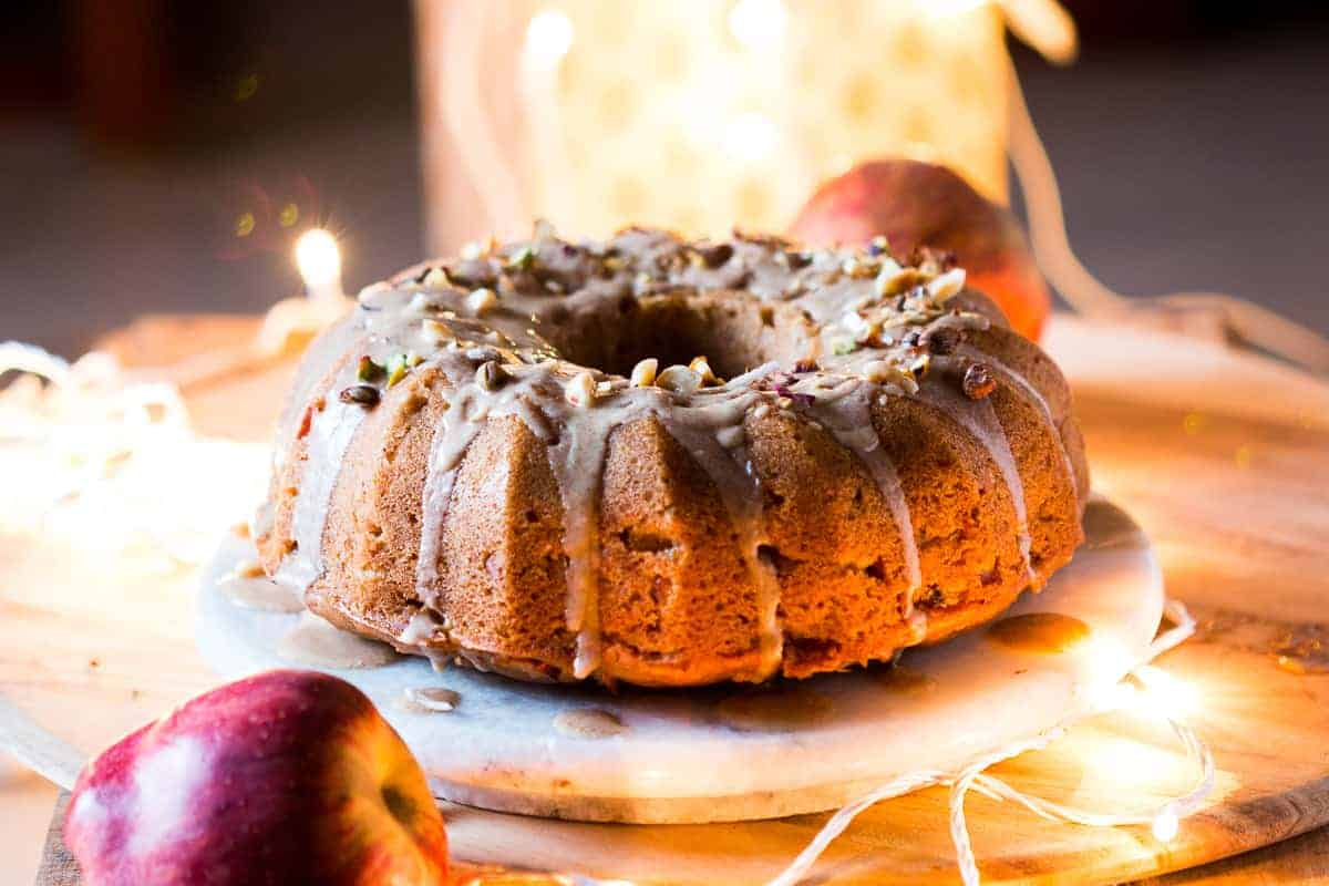 Garam Masala Eggless Apple Bundt Cake - easy, moist, spiced cake made with fresh apples and glazed with a brown butter rum sauce.