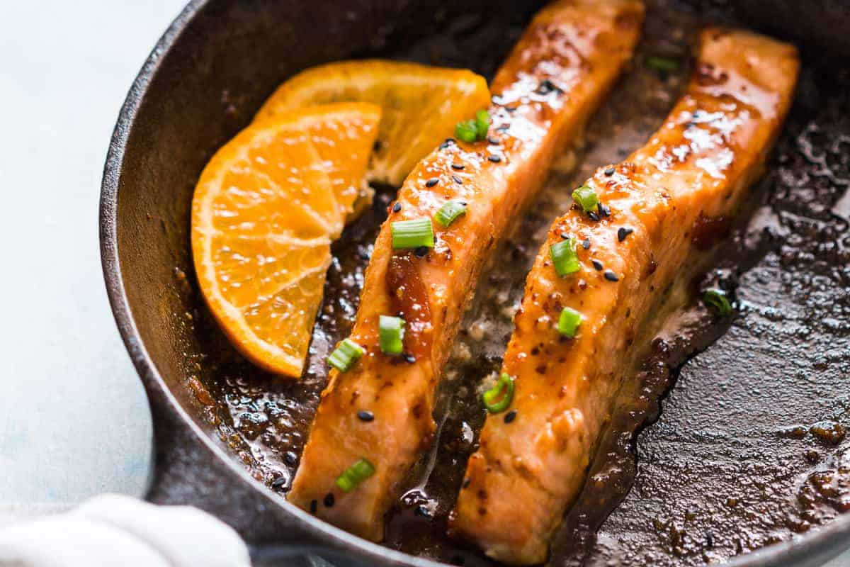 Pan seared orange mustard salmon - easy, healthy, 15 minute dinner with a sticky marinade. Clean eating ingredients, serve with pasta, or cauliflower rice