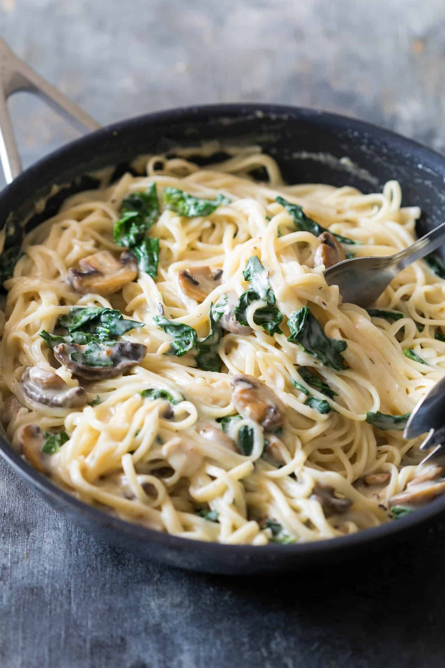 Creamy lemon mushroom kale linguine pasta is vegetarian, ready in 30 minutes with the best healthy alfredo style white sauce you'll make!