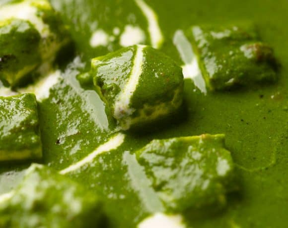 Closeup of the palak paneer gravy to show the luxurious, rich curry base