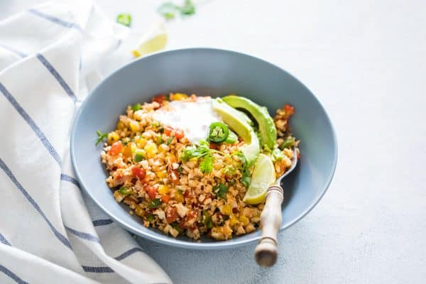 Low Carb Mexican Cauliflower Rice is a healthy, paleo friendly, keto friendly, vegan side dish recipe that is bursting with mexican flavours and ready in 30 minutes!