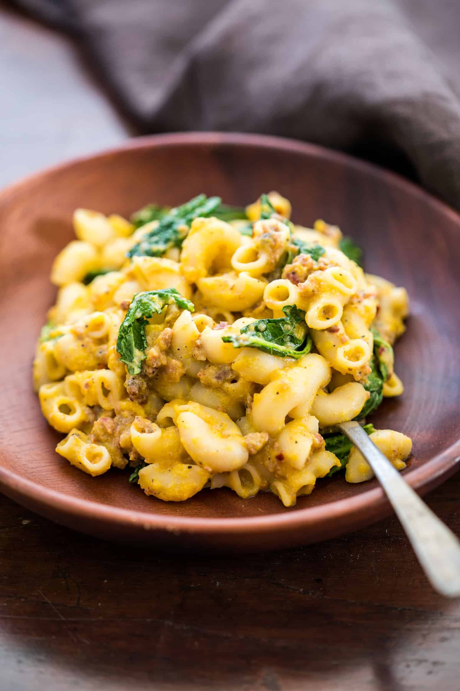 Creamy pumpkin sausage mac and cheese with kale is pure comfort food! It's a fast, easy dinner recipe when you crave homemade pasta