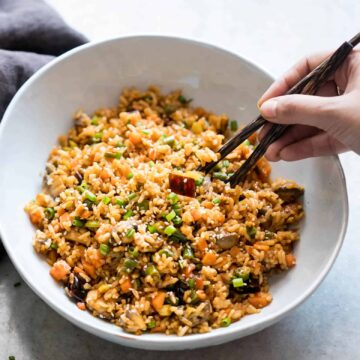 Schezwan Fried Rice from leftover rice served in a white bowl.