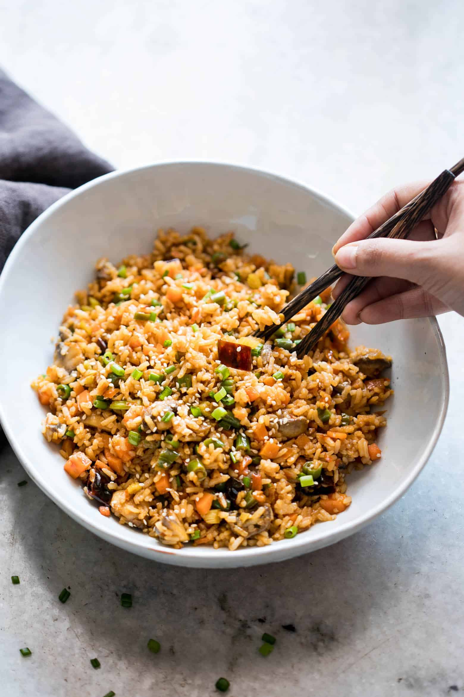 This is the best chinese schezwan fried rice you'll make - loaded with vegetables, spicy and super easy! Made with sichuan sauce, it's the best way to use leftover rice.