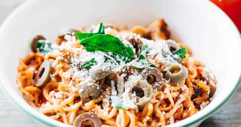 Italian maggi served in a white bowl.
