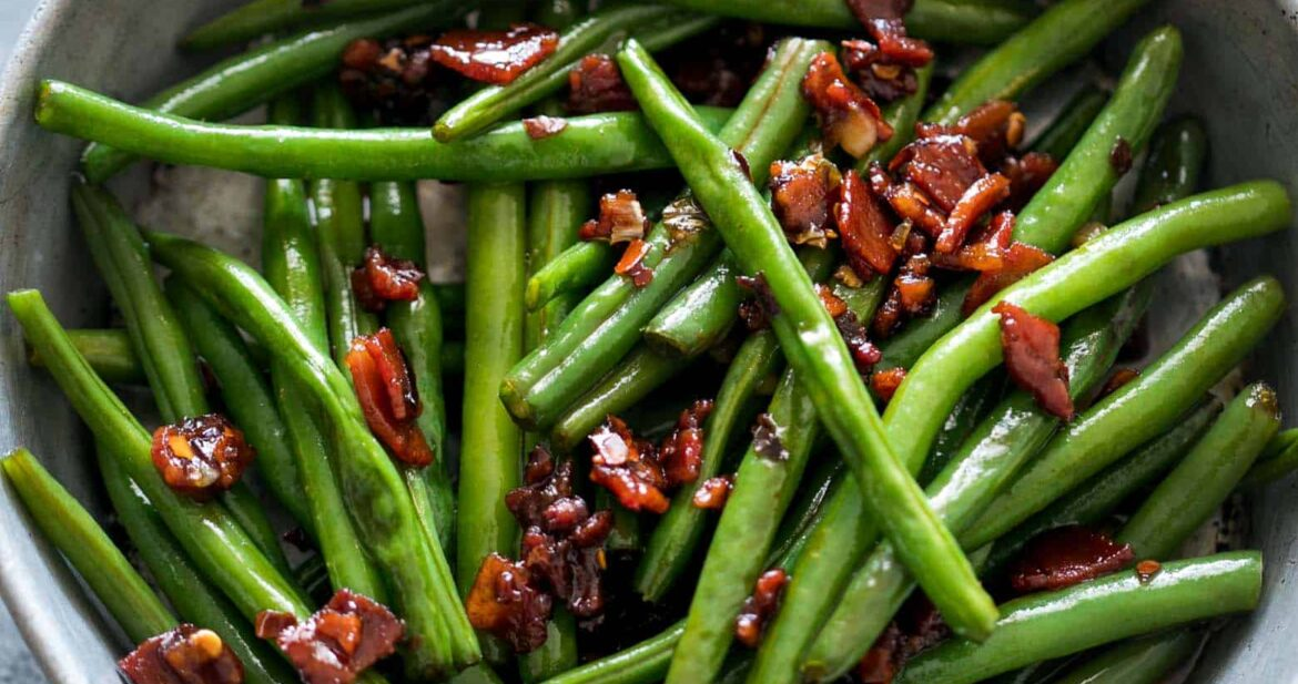 Sauteed Brown Sugar Bacon Garlic Green Beans in a pan.