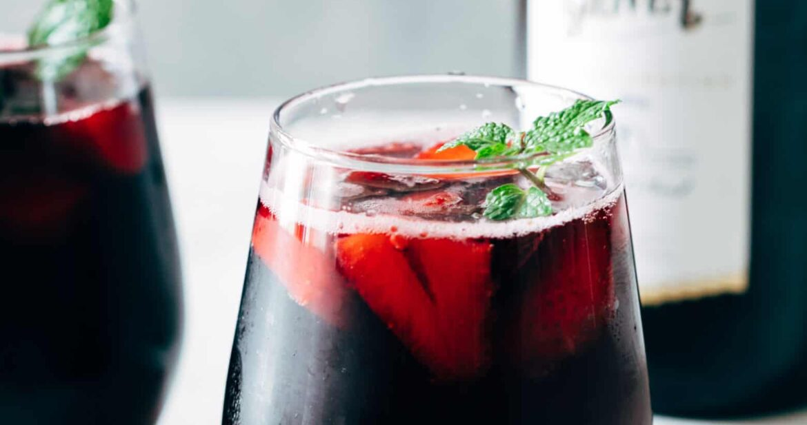 Summer Berry Red Wine Spritzer served with mint in glasses.
