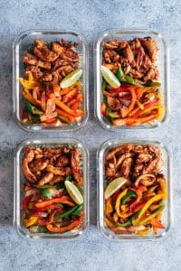 Chicken fajita with cilantro lime quinoa and grilled veggies in glass containers.
