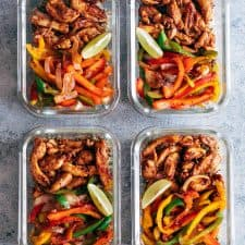 Chicken fajita with cilantro lime quinoa and grilled veggies in glass containers.