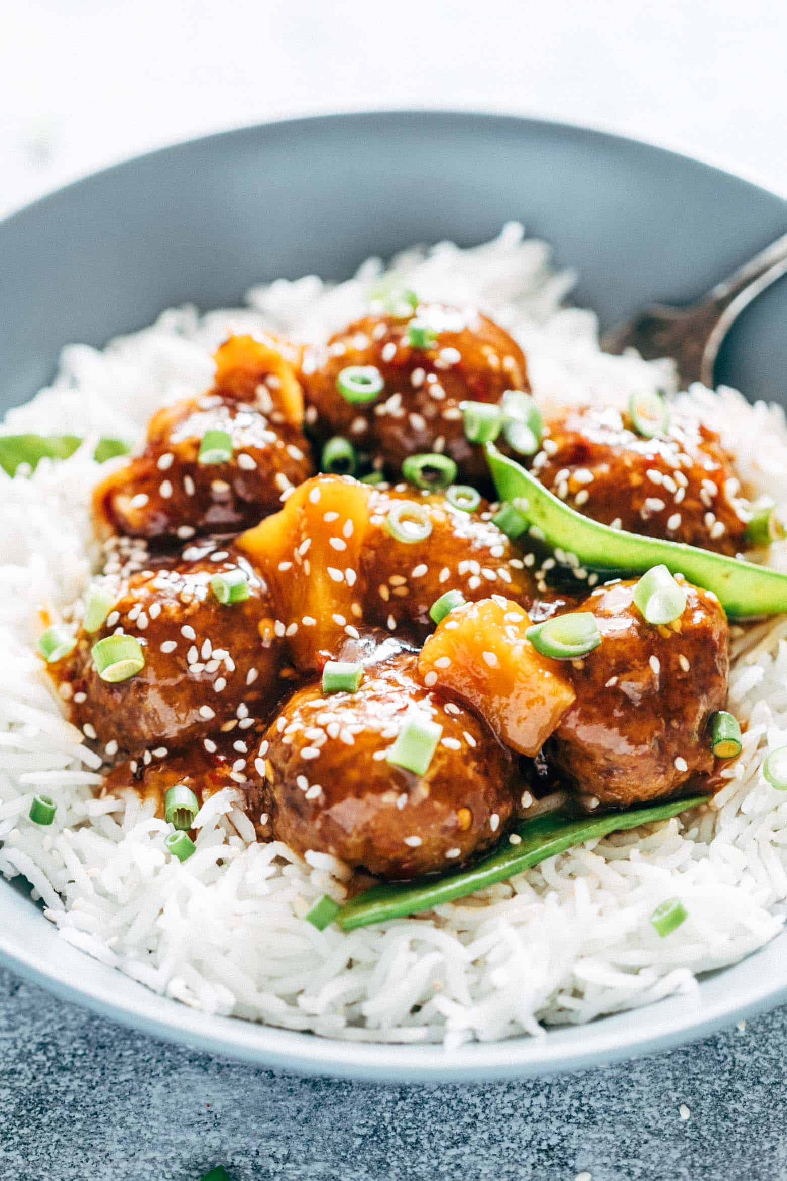 Asian inspired slow cooker teriyaki meatballs with pineapple are super easy, low carb and can be made in your crockpot. Juicy, succulent, these teriyaki pineapple meatballs can also be baked in the oven.