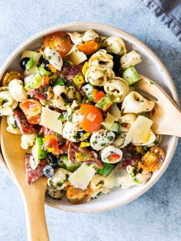 Italian Antipasto Tortellini Pasta Salad put together in a white bowl.