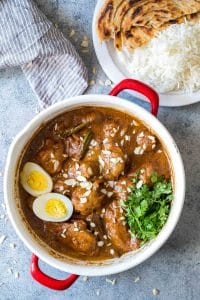 Mughlai Chicken garnished with coriander and boiled eggs.