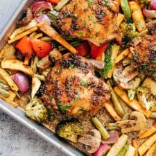Honey Balsamic Chicken in a sheet pan with veggies.