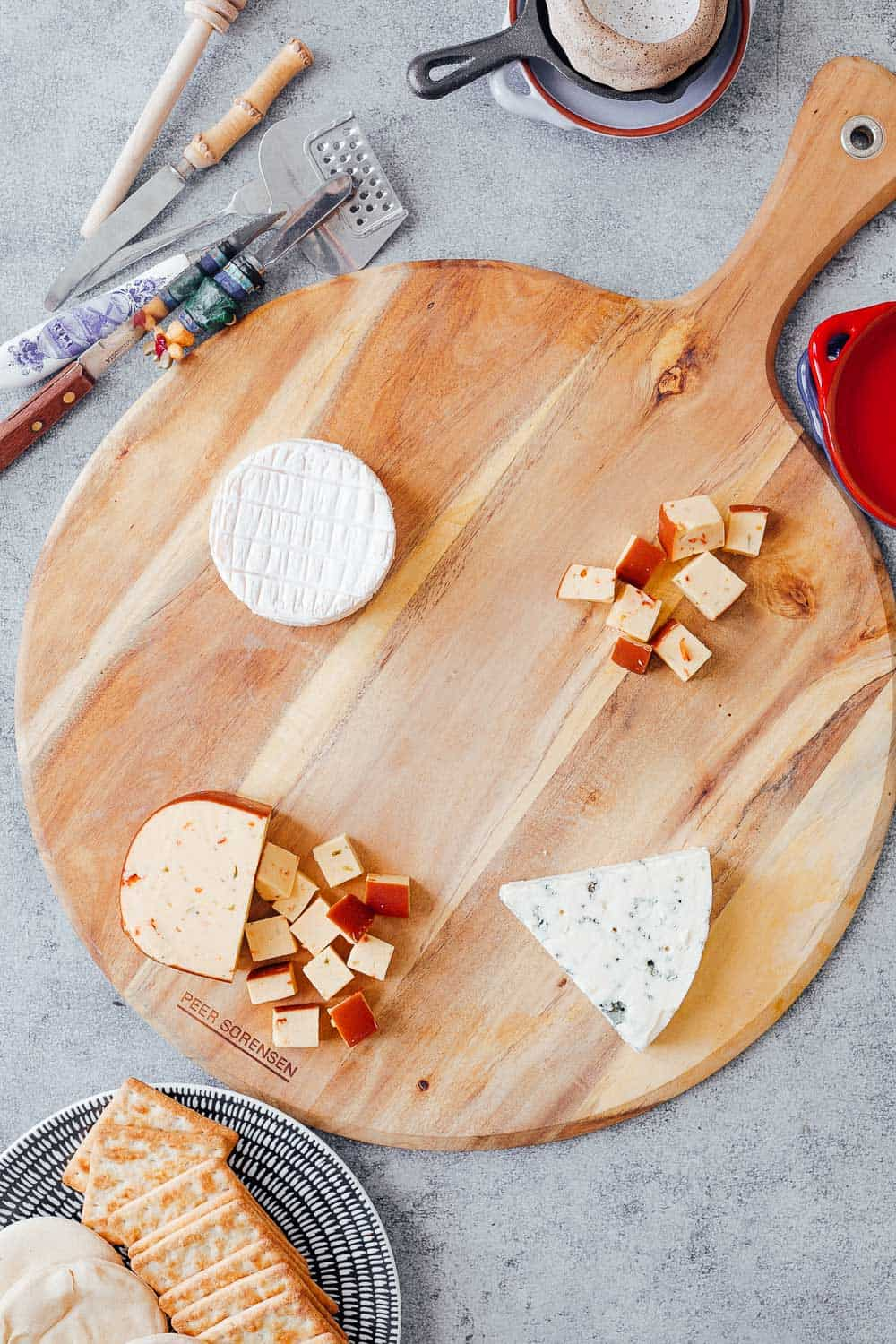 Step #2 to making the ultimate wine and cheese board on a budget is to pick the right cheeses. Pictures here is smoked jalapeno cheddar, brie and danish blue cheese