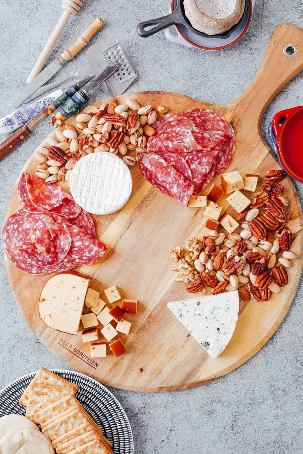 Step #3 to create the ultimate wine and cheese board on a budget is to choose cheap charcuterie for the board along with any nuts that you already have in your pantry. Salami is usually cheaper than more expensive cuts like parma ham