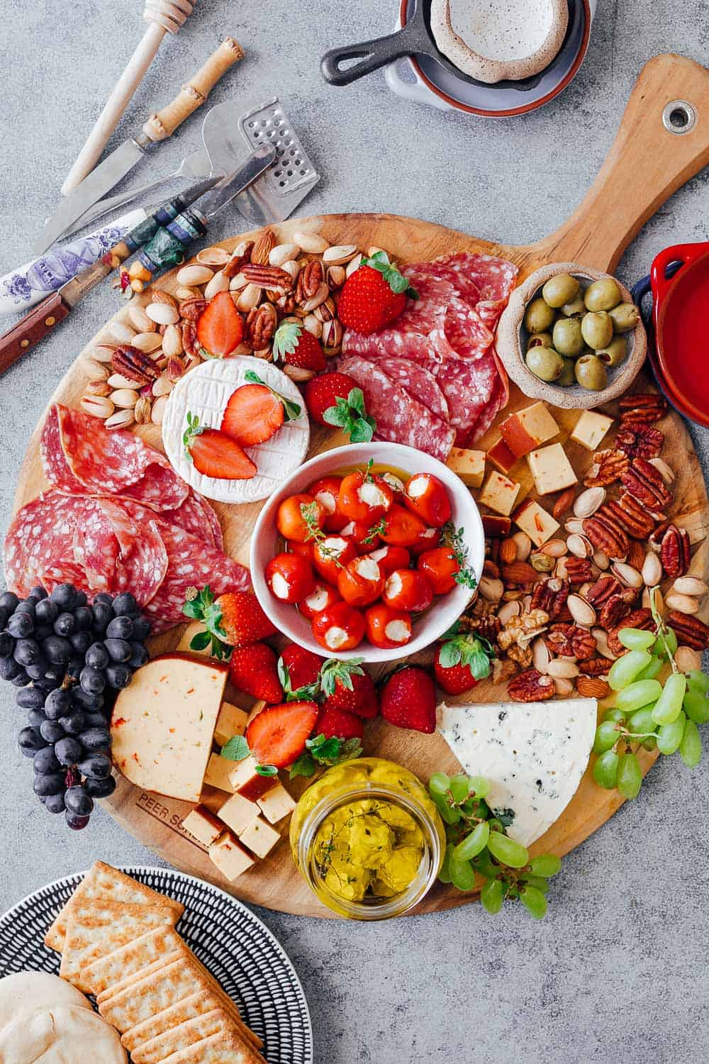 Step #5 in creating the ultimate wine and cheese board is to add local, seasonal fruits to the board. This helps keep the cost down as seasonal fruits are usually the cheapest