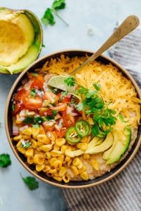This Mexican oatmeal bowl is the healthier version of a Mexican breakfast bowl. The oatmeal is seasoned with all the spices that go into your favorite taco, and then topped with salsa, corn, avocado, jalapenos and cheddar. Super simple to make but you'll feel like a king when you dig into this!