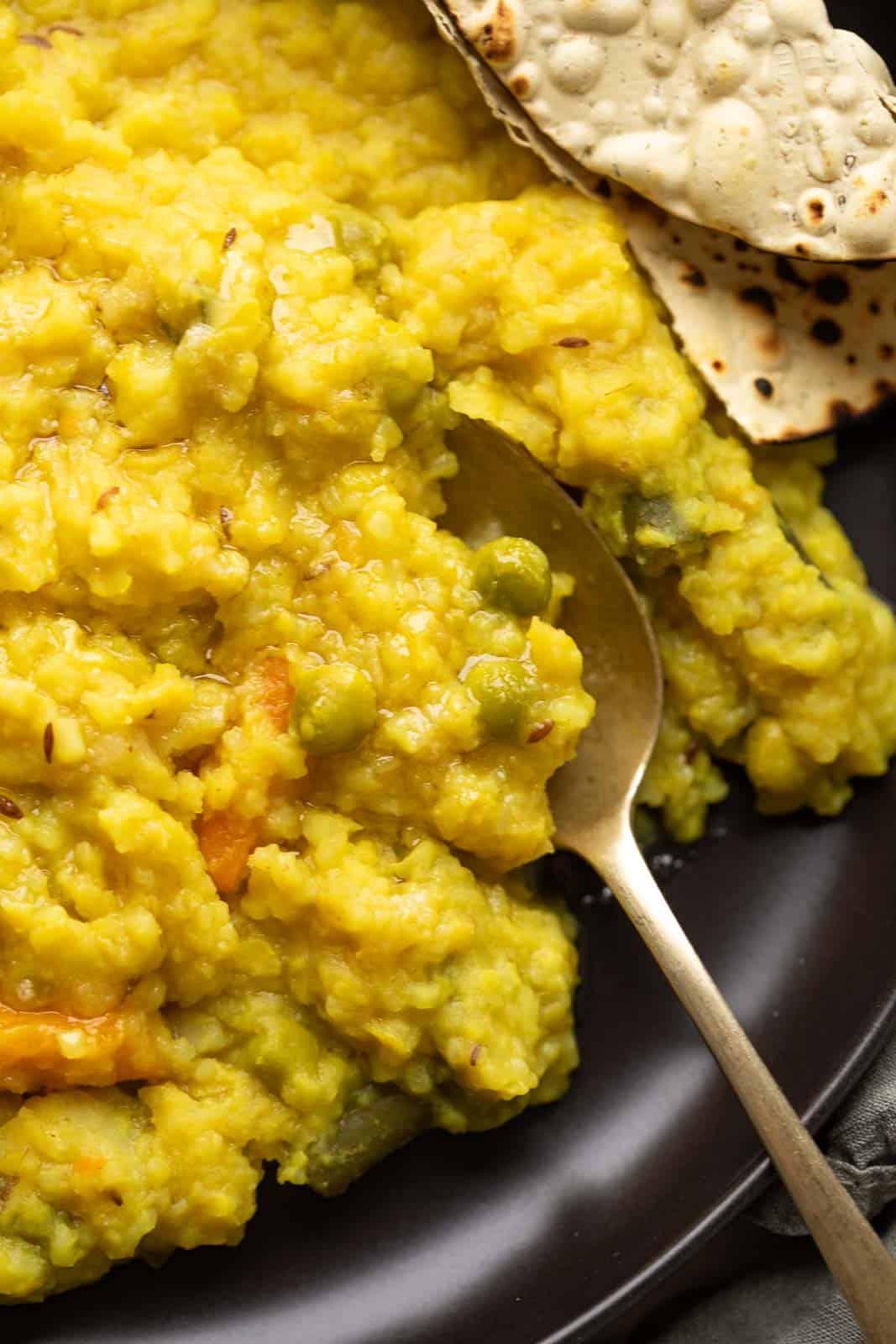 Closeup of khichdi in a spoon