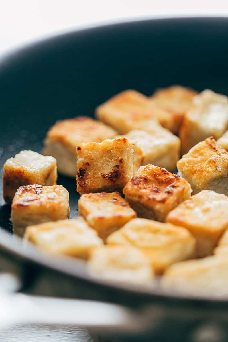 Crispy tofu panfried in a non stick pan till golden brown on all sides