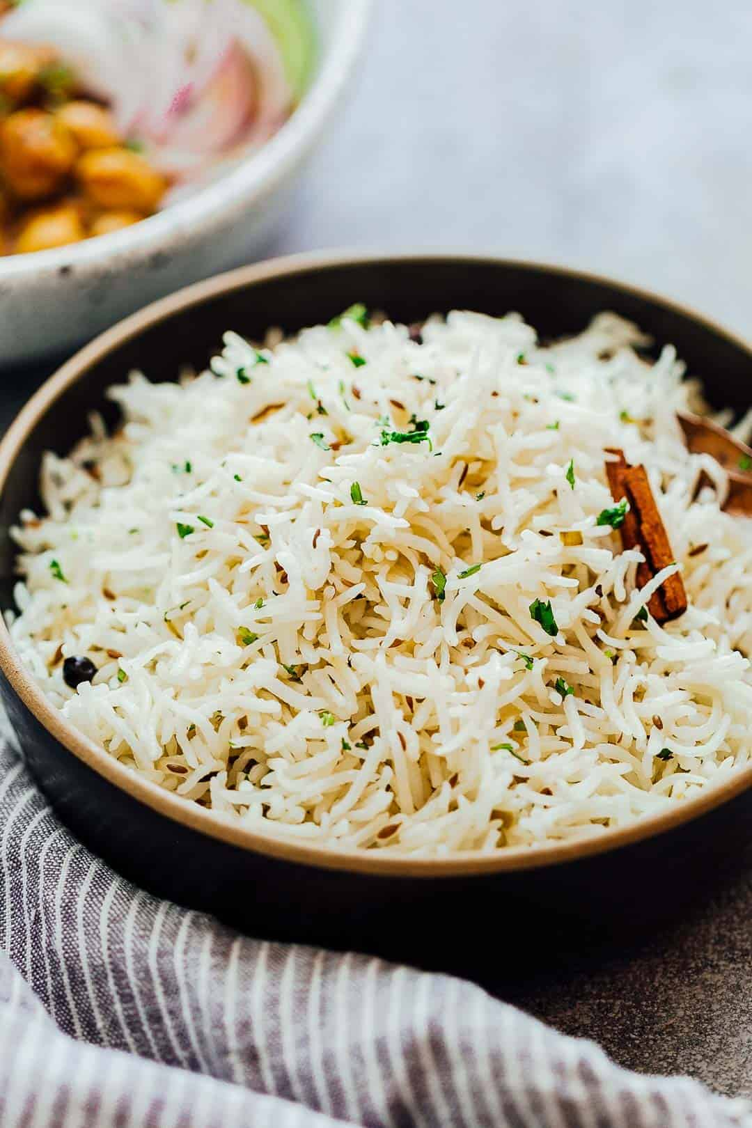 Close up of the perfect, steamed jeera rice or Indian cumin rice served in a bowl