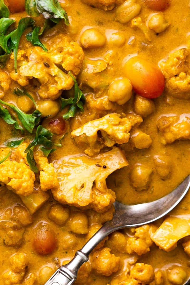 Closeup of Cauliflower Chickpea Coconut Curry with a spoon