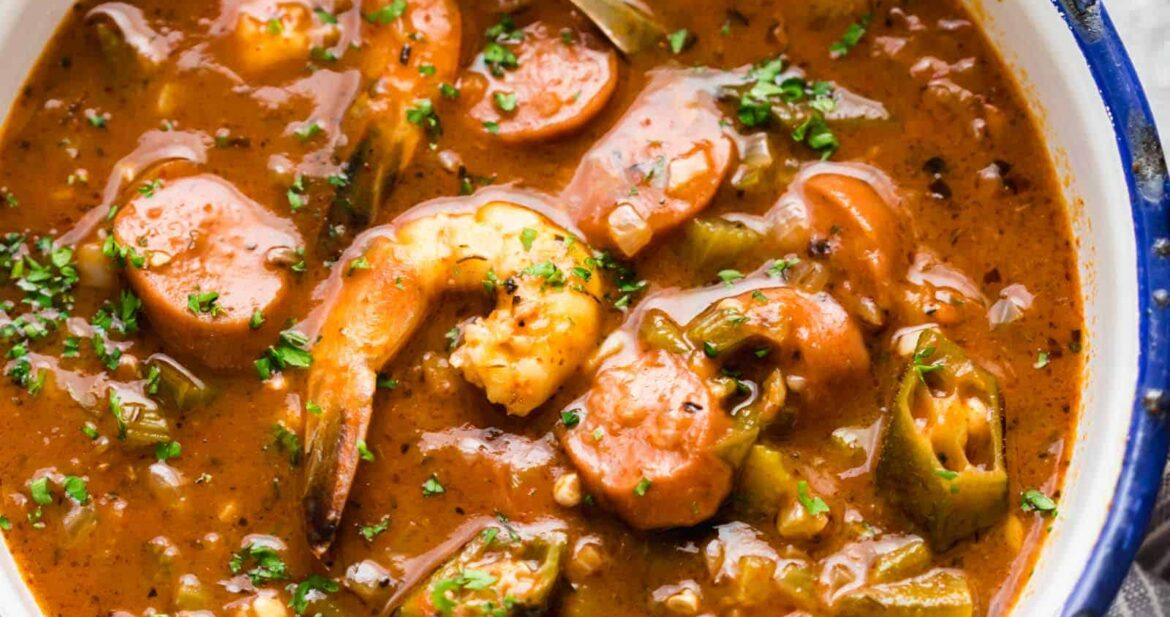 New Orleans Shrimp Sausage Gumbo served in an enamel bowl with a spoon