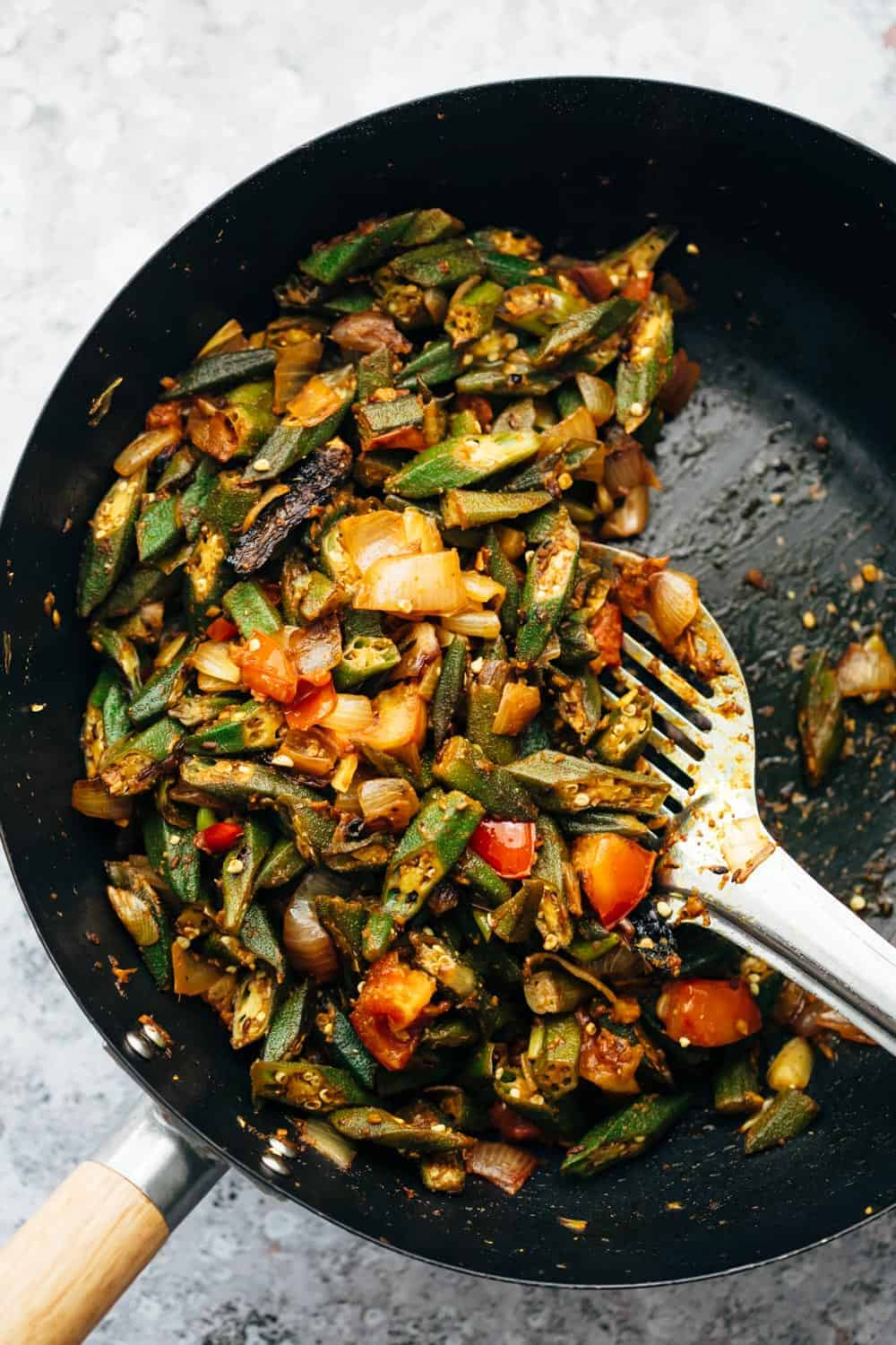 Overhead shot of bhindi masala fry in wok straight from the stove