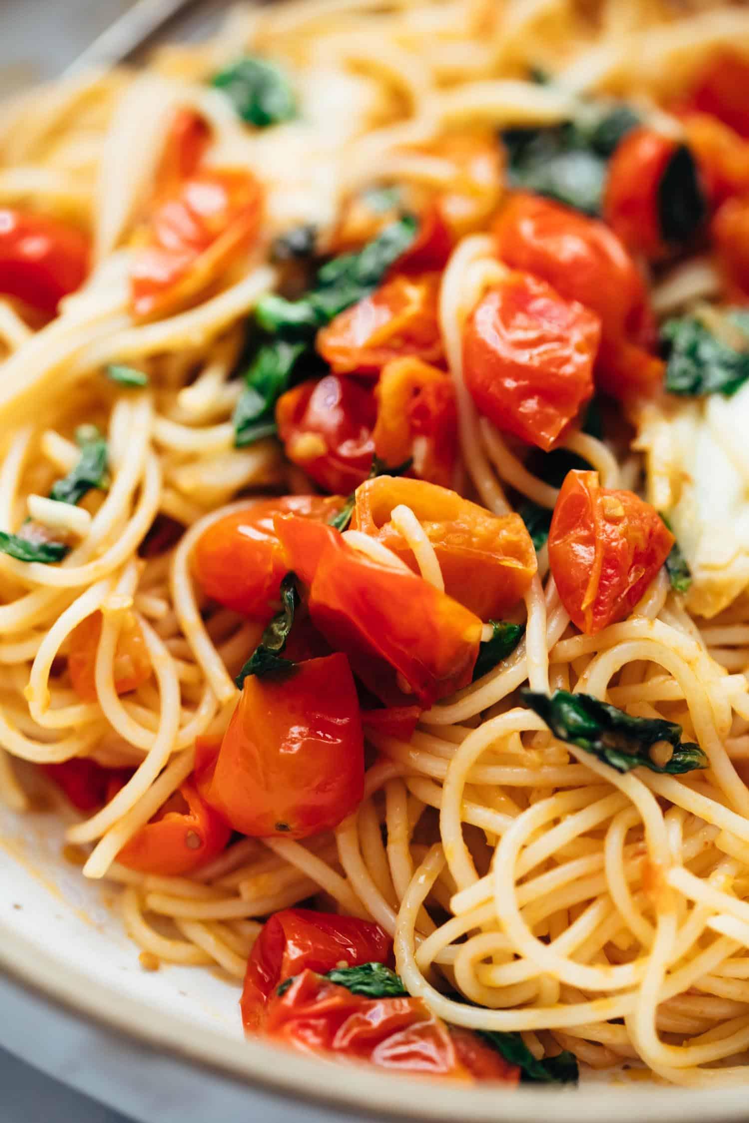 Closeup of cherry tomato basil pasta