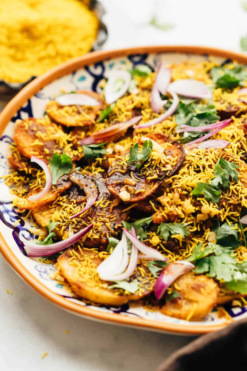 Closeup of easy aloo chaat - delhi style served on a plate with sev and lime on the side