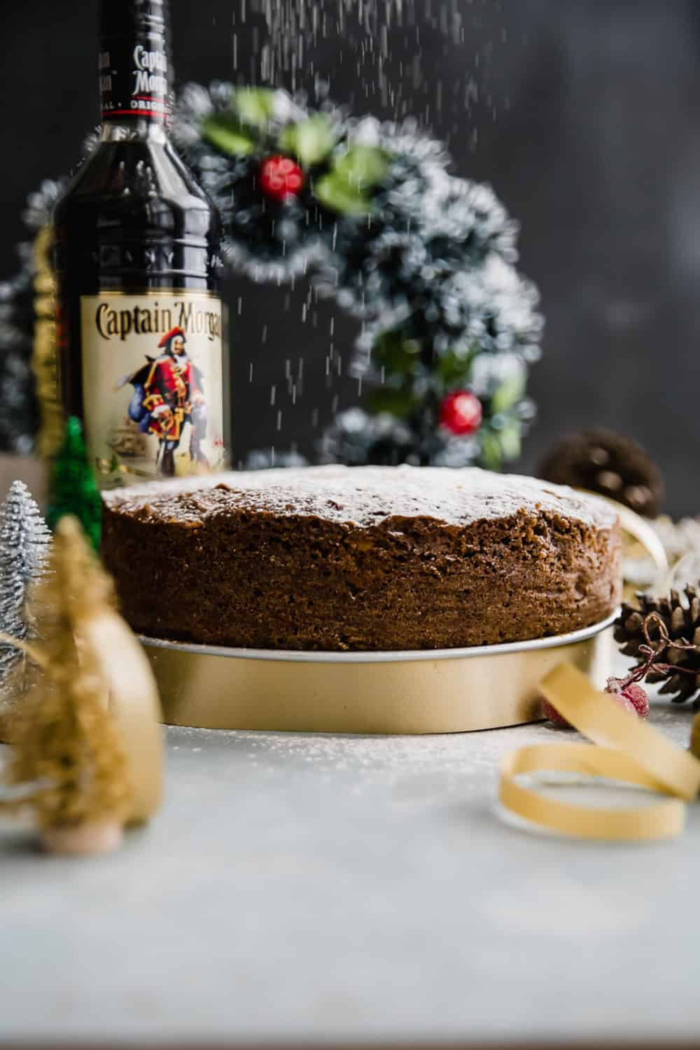 Last minute plum cake or christmas fruit cake set up on the table for slicing