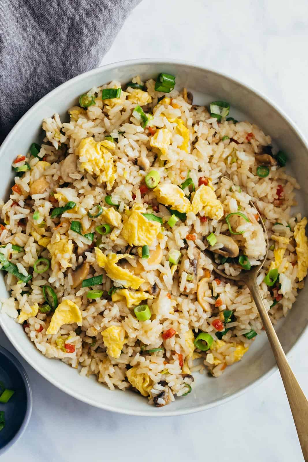 Egg Fried rice served in a bowl with a spoon