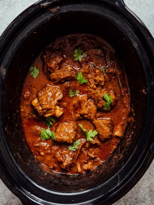 Slow cooker lamb curry pictured in a slow cooker