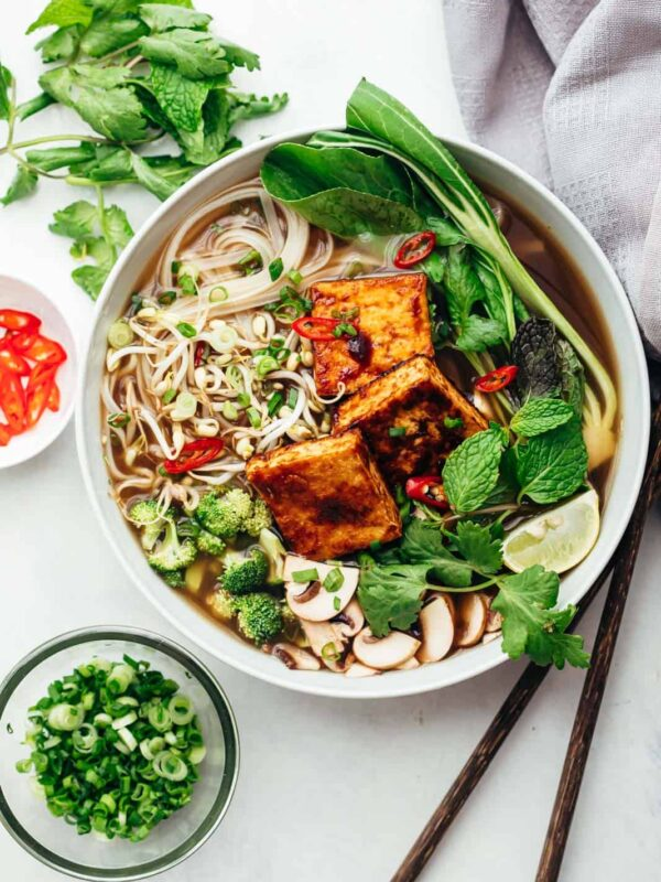 Vegetarian pho soup served in a bowl with lots of toppings