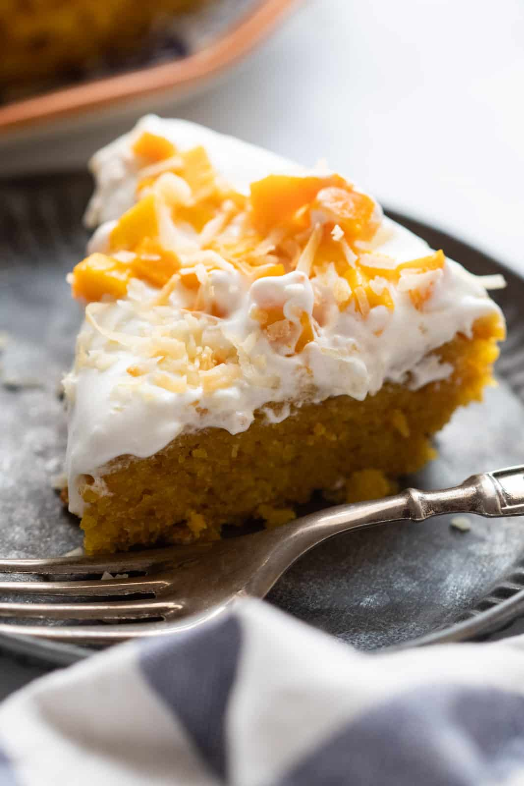 A slice of the eggless mango cake