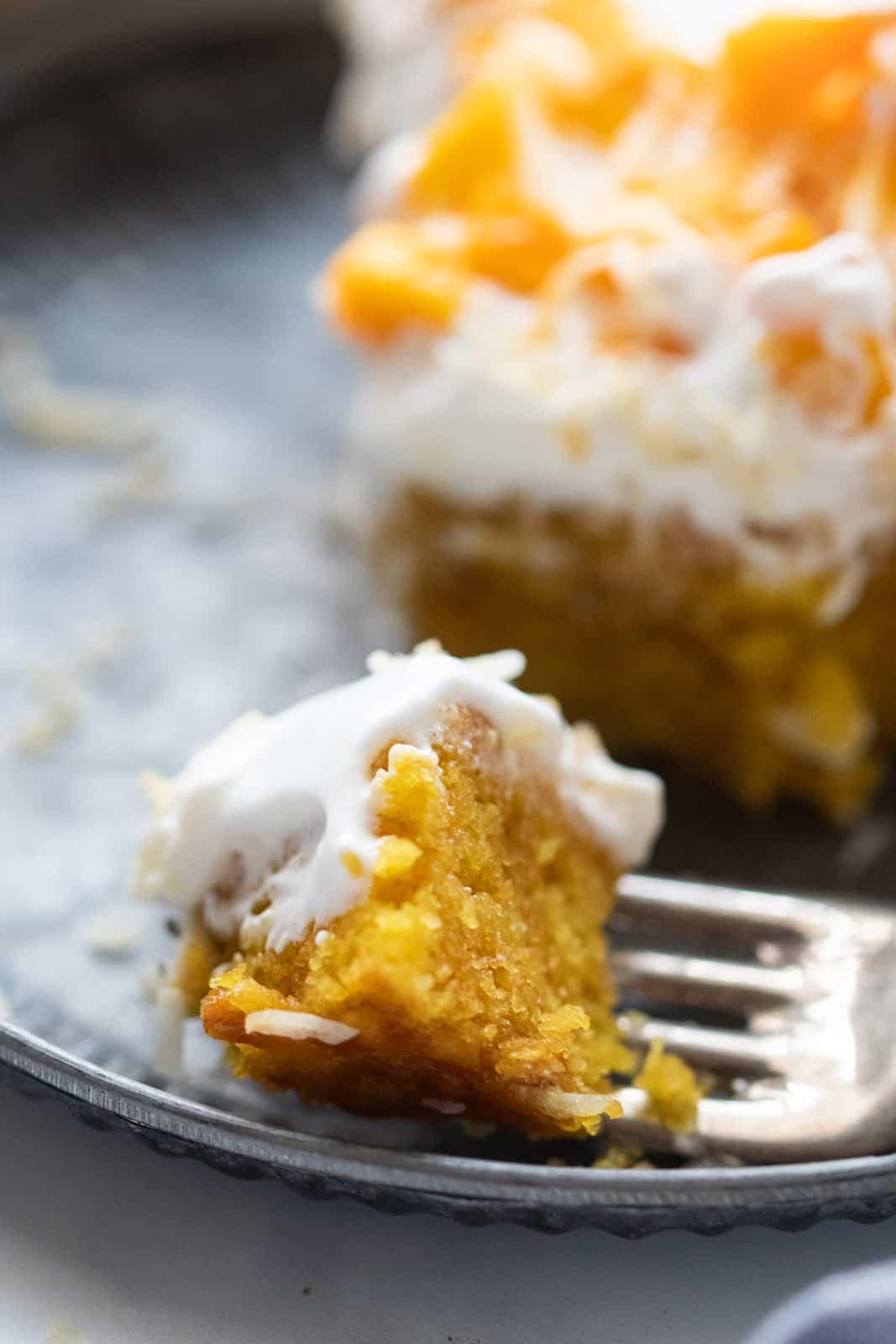 Closeup of a bite of eggless mango cake
