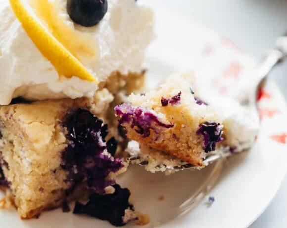 Closeup of a bite of lemon blueberry cake bars