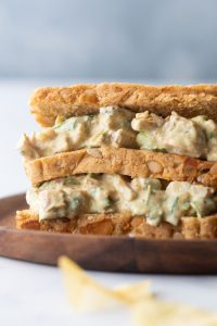 Closeup of curry chicken salad sandwich on a plate