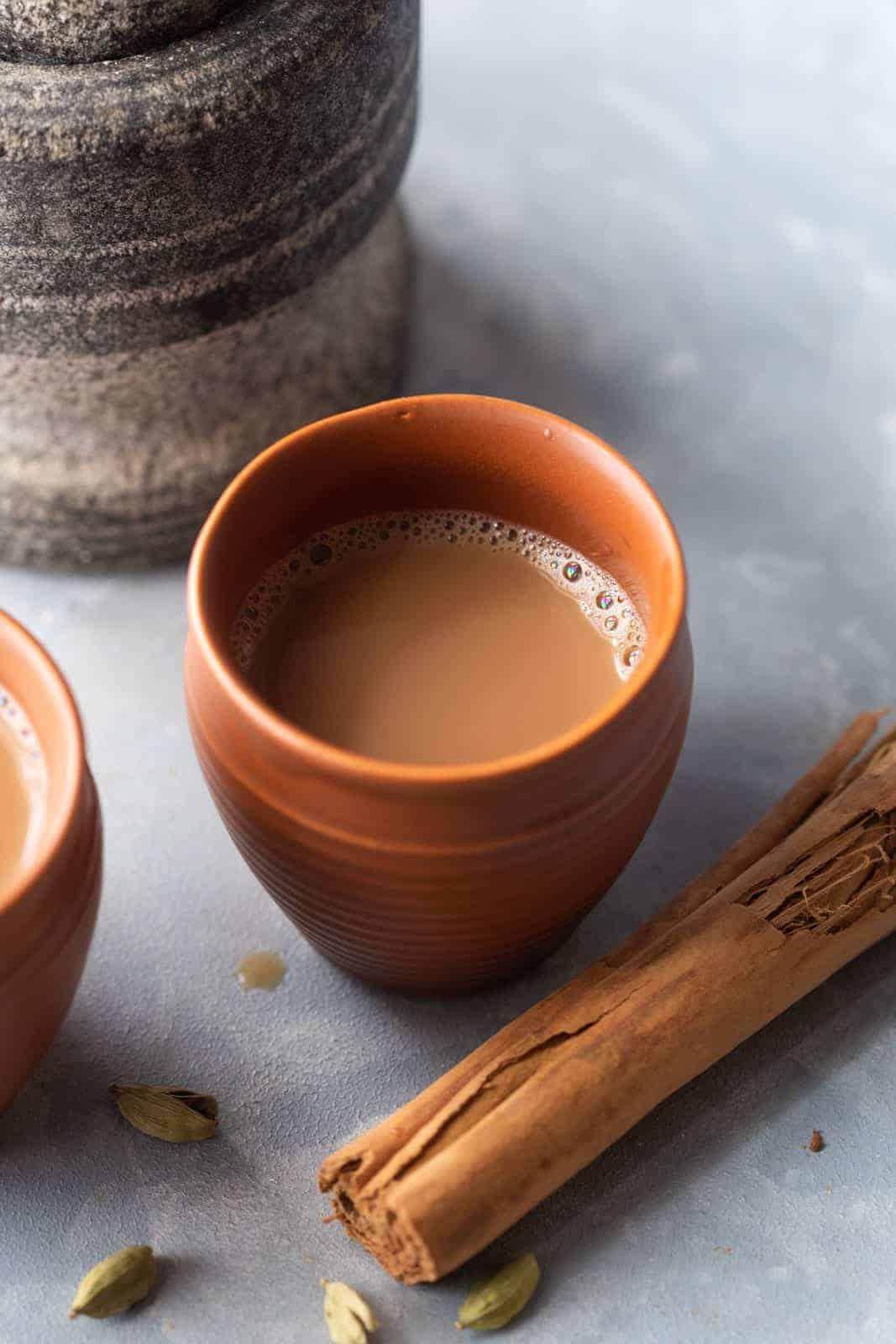 Masala Chai served in a terracota mug