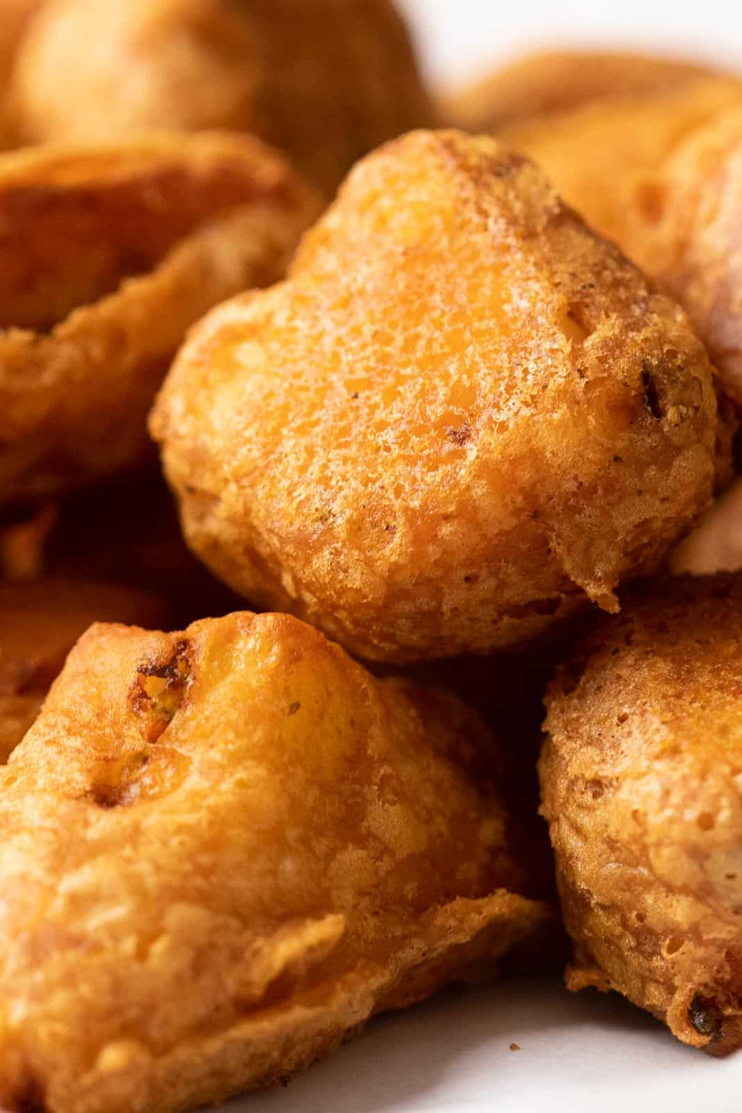 Closeup to show the crispy batter of paneer pakoras